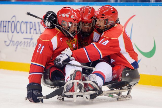 andrey-dvinyaninov-of-russia-celebrates-with-teammates-after-scoring-a-goal-in-sochi-in-2014