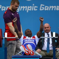 LONDON, ENGLAND - AUGUST 30: Patrick Ardon of France celebrates a successful lift in the Men's 48kg Powerlifting on day 1 of the London 2012 Paralympic Games at ExCel on August 30, 2012 in London, England. (Photo by Michael Steele/Getty Images)
