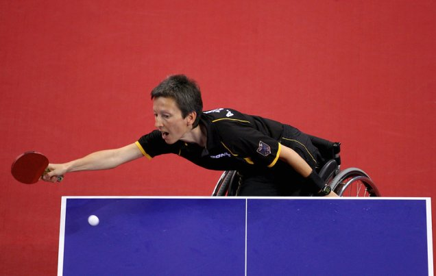 BEIJING, CHINA - SEPTEMBER 16: (CHINA OUT) Andrea Zimmerer of Germany competes in the Women's Team - Class 4/5 Table Tennis match between Andrea Zimmerer of Germany and Gu Gai of China at the Peking University Gymnasium during day ten of the 2008 Paralympic Games on September 16, 2008 in Beijing, China. (Photo by China Photos/Getty Images)