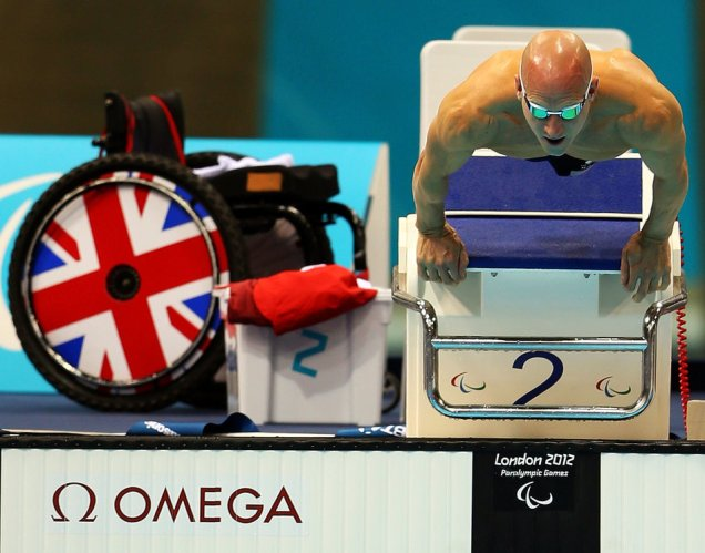 LONDON, ENGLAND - SEPTEMBER 05: James O'Shea of Great Britain dives from the blocks in the Men's 100m Breaststroke - SB5 Final on day 7 of the London 2012 Paralympic Games at Aquatics Centre on September 5, 2012 in London, England. (Photo by Mike Ehrmann/Getty Images)