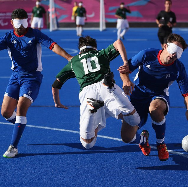 LONDON, ENGLAND - SEPTEMBER 08: Ricardo Steinmetz Alves of Brazil clashes with David Labarre (R) and Abderrahim Maya of France in the gold medal match during the 5 a-side Football on day 10 of the London 2012 Paralympic Games at on September 8, 2012 in London, England. (Photo by Julian Finney/Getty Images)