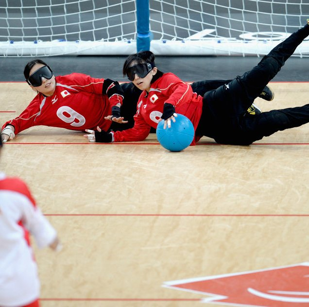 LONDON, ENGLAND - SEPTEMBER 07: Rie Urata of Japan and Akiko Adachi block the ball during their Women's Team Goalball Gold Medal match against China on day 9 of the London 2012 Paralympic Games at The Copper Box on September 7, 2012 in London, England. (Photo by Dennis Grombkowski/Getty Images)