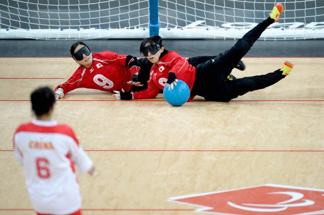 rie-urata-and-akiko-adachi-of-japan-block-the-ball-at-the-2012-paralympic-games